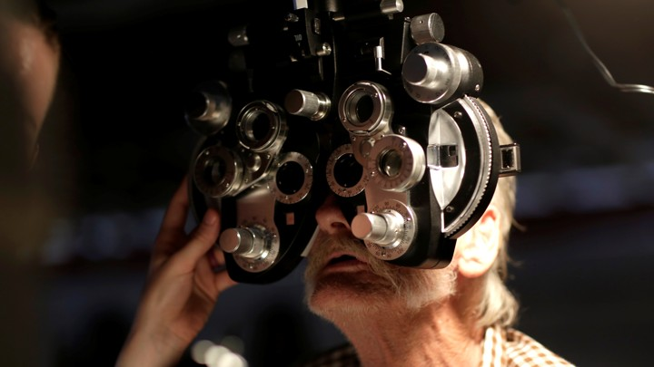 A man receives an eye exam at the Remote Area Medical Clinic in Wise, Virginia